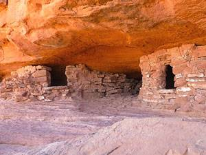 Two granaries beneath a ledge on the Aztec Butte trail.